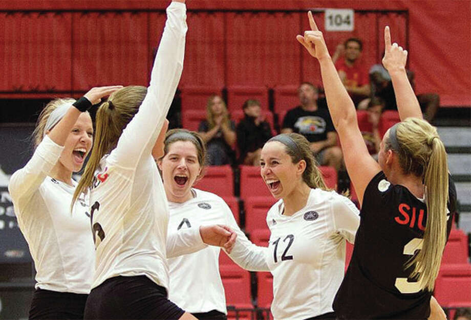 SIUE's (from left) Carley Ramich, Dylynn Otte, Alicia Streetar, Sami Knight and Katie Shashack celebrate a point during the Cougars' three-set sweep of Evansville on Saturday night at Vadalabene Center in Edwardsville. Photo: SIUE Athletics