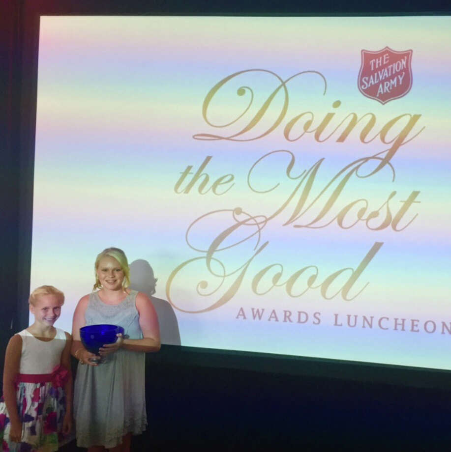 "The St. Louis Midland Chapter of the Salvation Army recently honored sisters Taylor Freer, 12, and Lily Freer, 9, of Godfrey, with its ""Doing the Most Good"" award in the youth division. An award ceremony was held Aug. 19 at the Chase Park Plaza in St. Louis. Photo: For The Telegraph"