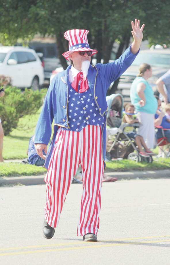 Uncle Sam waves to the crowd while walking in the annual Granite City Labor Day Parade, sponsored by the Greater Madison County Federation of Labor.