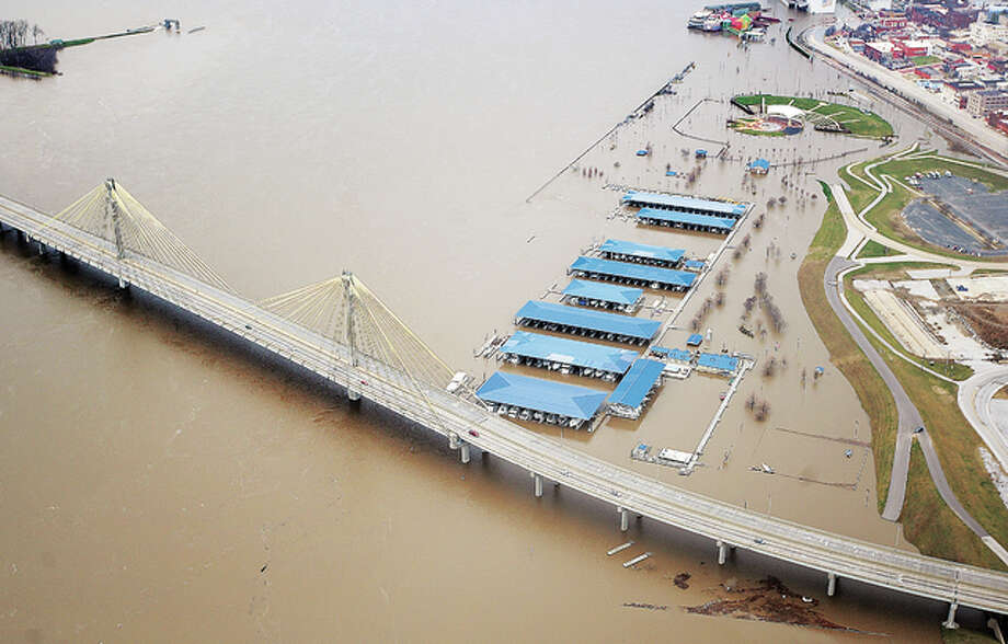 An aerial view of flooding on the Alton riverfront shows Riverfront Park mostly under water in December of 2015. Whether a power outage or severe storm that forces people to stay in their homes, or a flood that forces people to evacuate, proper planning and preparation can make the difference not only between life and death, but between being miserable or comfortable. Photo: John Badman|The Telegraph