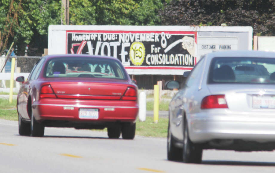 Cars pass a billboard on East Edwardsville Road in Wood River promoting consolidation of the East Alton and Wood River-Hartford elementary school districts with the East Alton-Wood River High School District. A referendum on consolidation will be on the November ballot, and both sides are starting to gear up their campaigns.