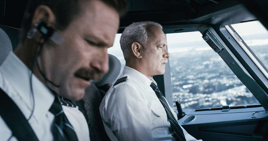 "This image released by Warner Bros. Pictures shows Tom Hanks, right, and Aaron Eckhart in a scene from ""Sully."" Photo: (Warner Bros. Pictures Via AP)"