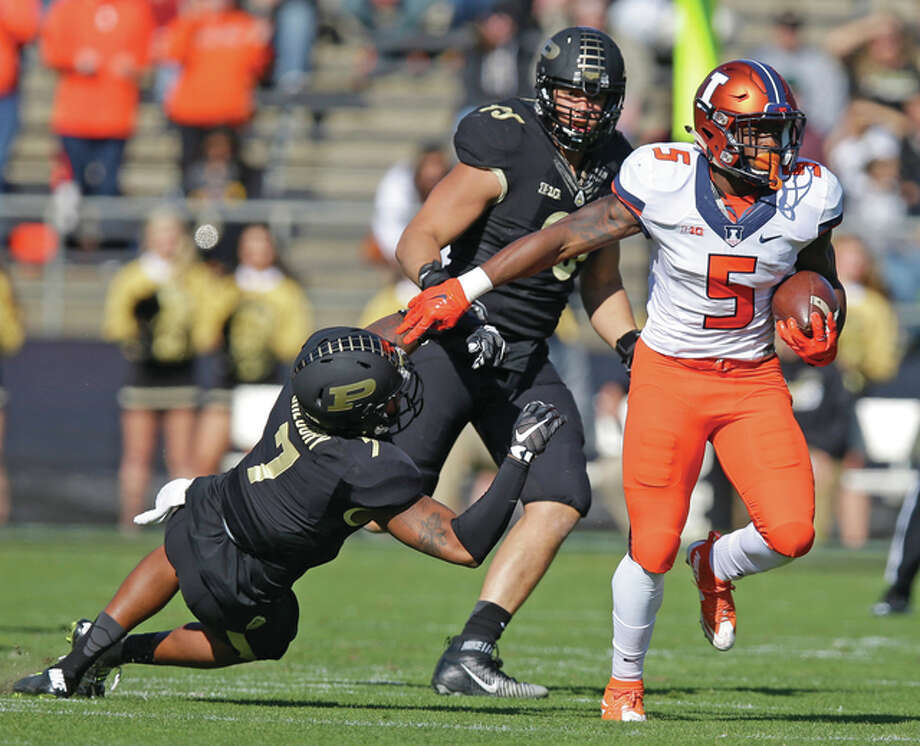 Illinois running back Ke'Shawn Vaughn (5), is shown eluding Purdue safety Robert Gregory (7) during a game last season in West Lafayette, Ind. The Illini, who are one big win into the tenure of new coach Lovie Smith, go up against North Carolina on Saturday in Champaign. Photo: Associated Press