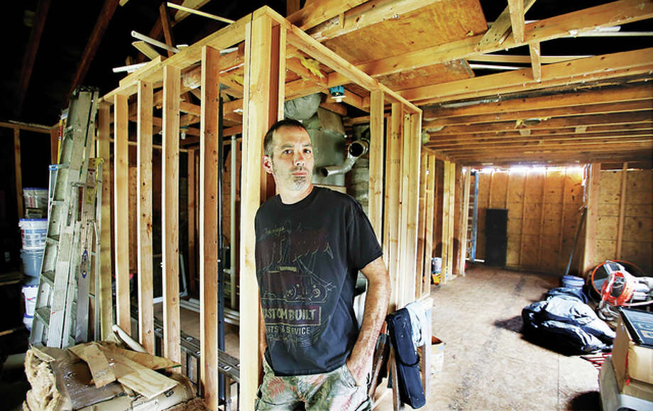 Chris Carter stands inside the house at 731 Dugger in Bethalto. He claims faulty instructions from a former building and zoning administrator made the property inhabitable, costing him at least $18,000. The administrator now faces multiple charges, including falsifying permits.