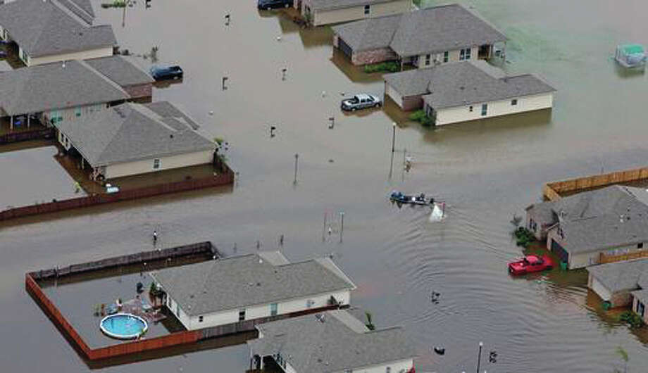 FILE- In this Saturday, Aug. 13, 2016 file aerial photo, a boat motors between flooded homes after heavy rains inundating the region, in Hammond, La. Eleven years ago, Hurricane Katrina exposed huge gaps in the disaster response plans of Louisiana and the nation. Lessons learned from that 2005 monster storm formed the backbone of state and federal reaction as flooding ravaged 20 Louisiana parishes last month. (AP Photo/Max Becherer, File) (AP Photo/Max Becherer, File)