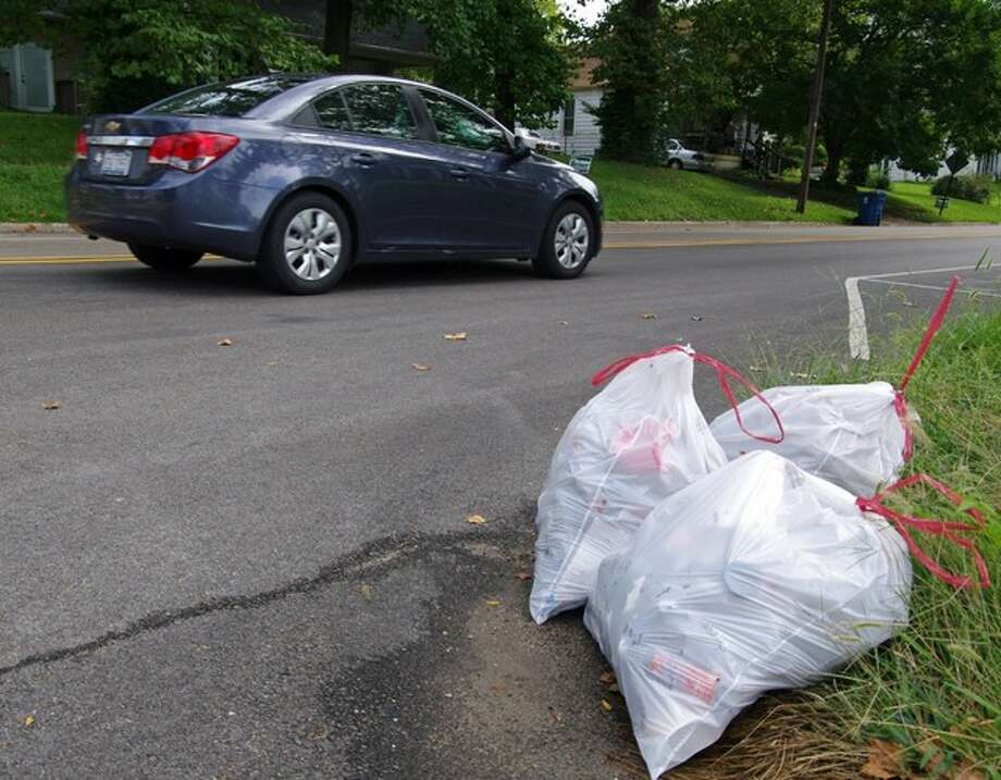 Bulging trash bags at the intersection of College and Johnson indicate the amount of progress made during the annual Fall Litter Cleanup sponsored by the Alton Beautification and Clean City Committee.