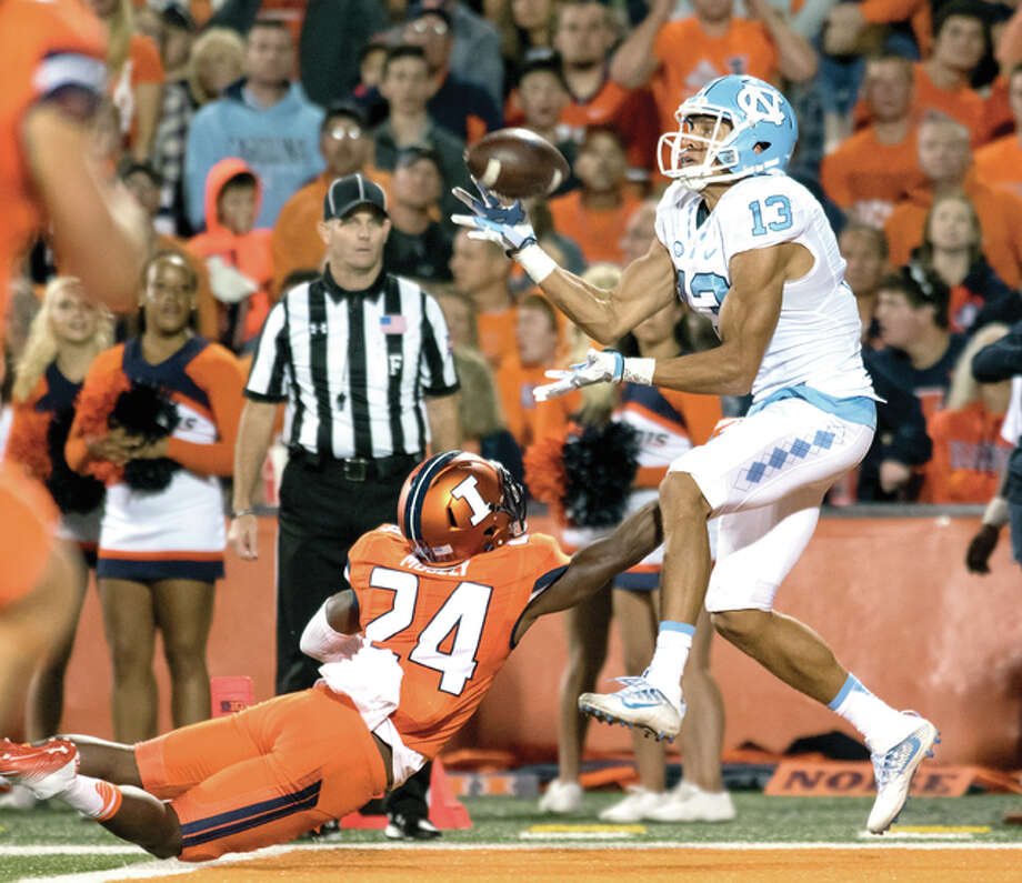 North Carolina wide receiver Mack Hollins (13) makes a touchdown catch over Illinois defensive back Darius Mosely (24) in the second half Saturday night in Champaign. Photo: AP