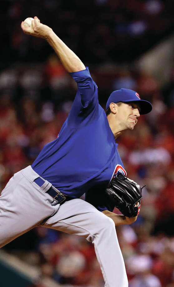 Cubs pitcher Kyle Hendricks works to the plate in the first inning Monday night at Busch Stadium. Hendricks took a no-hitter to the eighth inning before giving up a homer to the Cardinals' Jeremy Hazelbaker to lead off the ninth inning. Photo: Associated Press