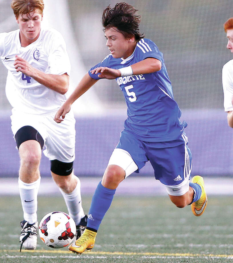 Marquette's Zach Weinman scored a goal in his team's 4-1 victory over Granite City Monday nibght at Gordon Moore Park. He is shown in action against Collinsville. Photo: Billy Hurst File Photo | For The Telegraph