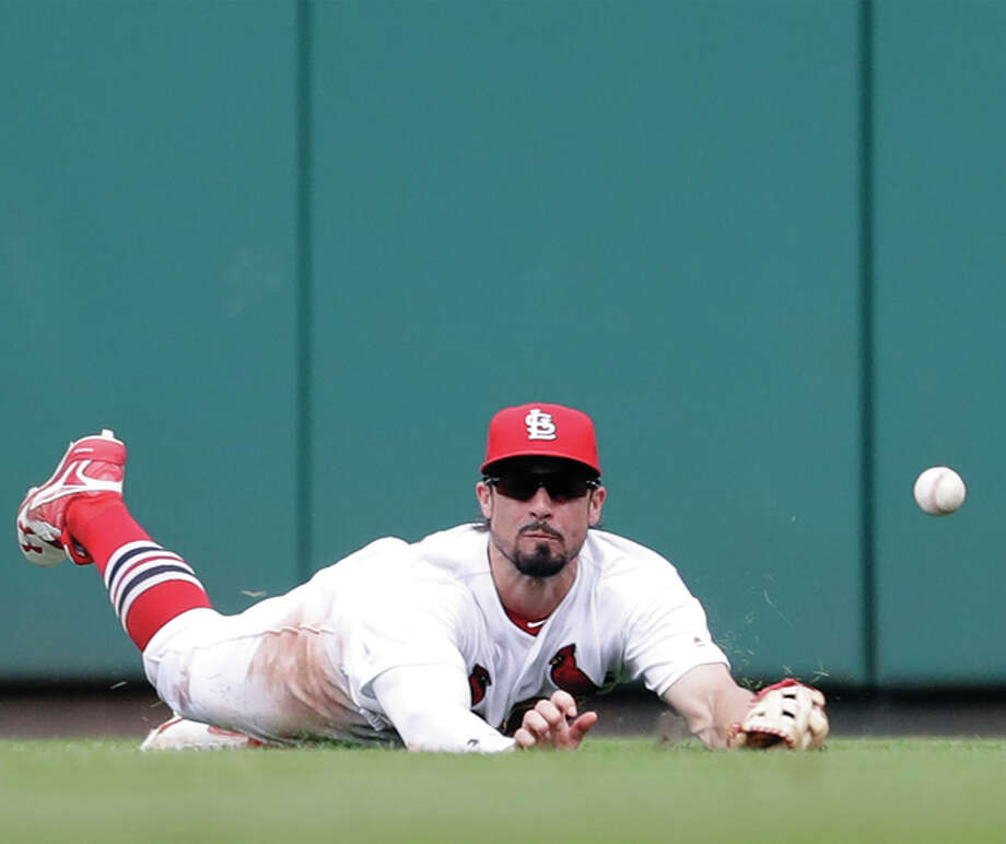 Cardinals center fielder Randal Grichuk dives but can't reach an RBI triple by the Cubs' Kris Bryant during the ninth inning Wednesday afternoon at Busch Stadium. Photo: Associated Press