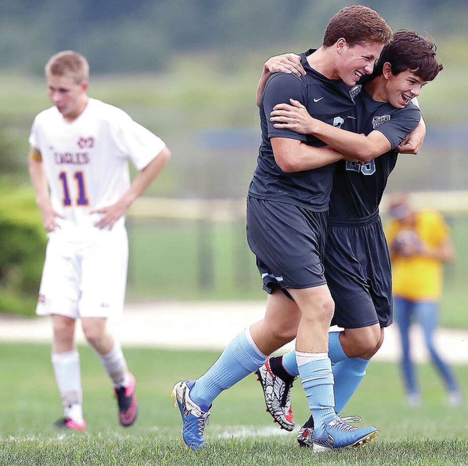 Jersey's Luke Palcheff, middle, celebrates with Seth Isringhausen as CM's Trevor Panyik, left, reacts after Palcheff scored a goal during Thursday's game at Bethalto Sports Complex. Credit: Billy Hurst - For the Telegraph Photo: Billy Hurst | For The Telegraph