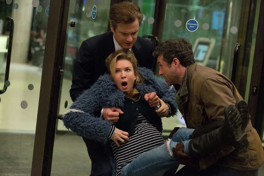 "This image released by Universal Pictures shows Renee Zellweger, foreground center, Patrick Dempsey, right, and Colin Firth in a scene from ""Bridget Jones's Baby."" Photo: (Giles Keyte/Universal Pictures Via AP)"