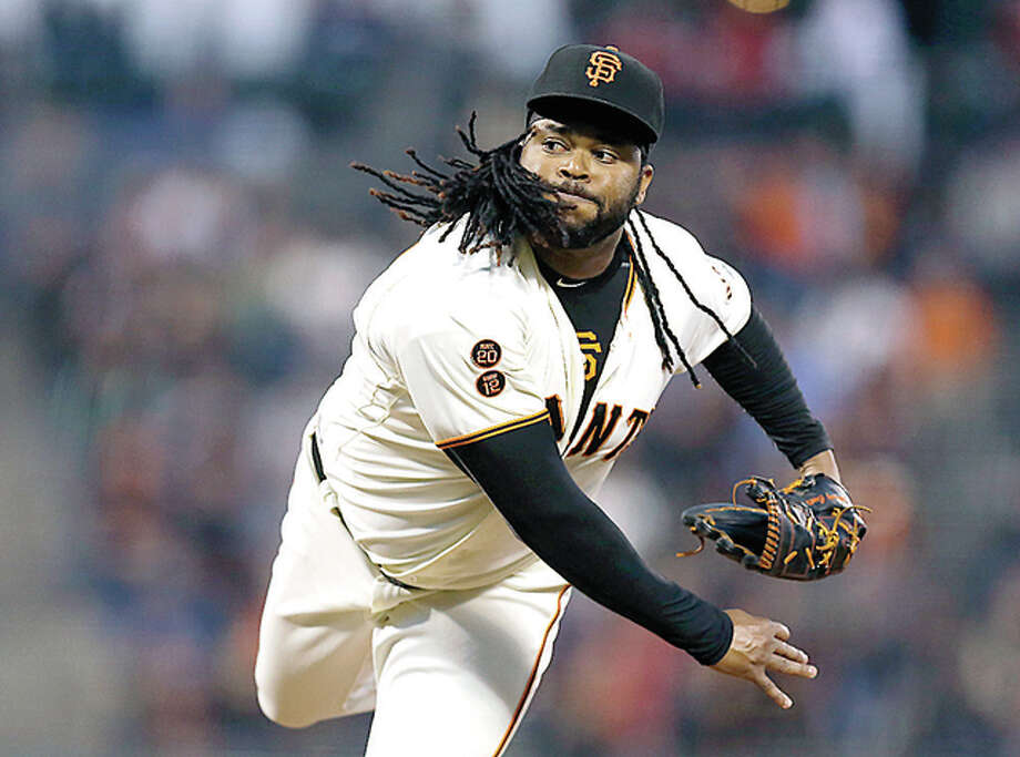 Giants pitcher Johnny Cueto works against the Cardinals Thursday night in San Francisco. Photo: AP