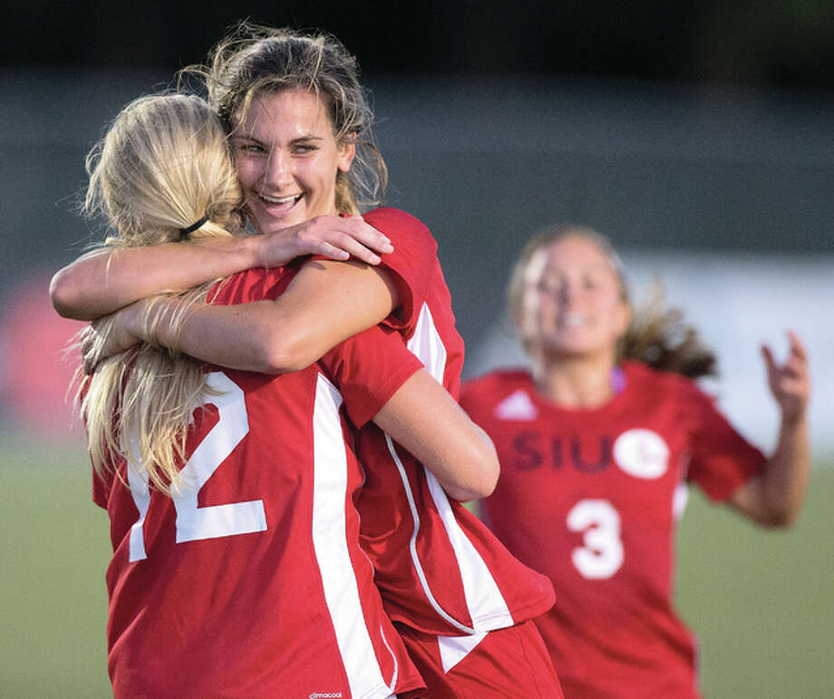 SIUE's Caroline Hoefert (facing) scored the game-tying goal for the Cougars in a 1-1 tie with Missouri State University Friday night. Hoefert, a Marquette Catholic High grad, is shown in earlier action this season celebrating with SIUE teammate and Civic Mmeorial High grad Lindsey Fencel. Photo: SIUE File Photo
