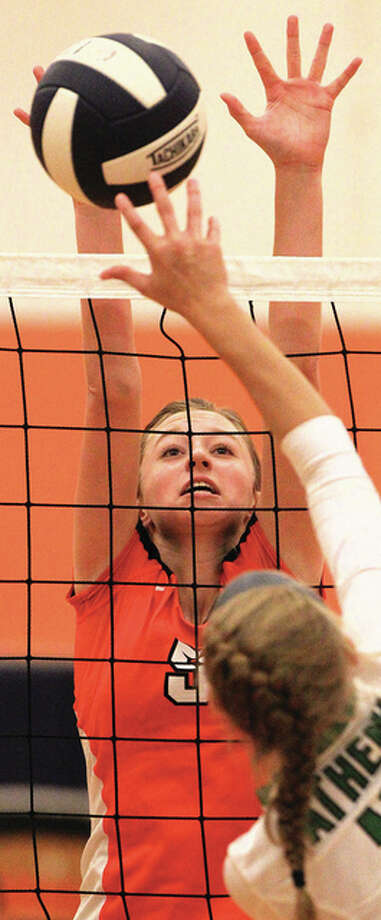 Greenfield's Hailey Driscoll makes a block during a match Saturday against Athens at the Ray Long Pretzel Classic Volleyball Invitational at New Berlin. Photo: Dennis Mathes | Journal-Courier