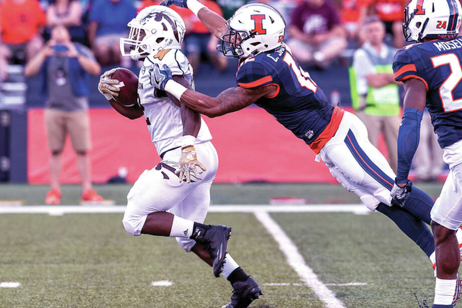 Illinois defensive back Chris James (12) tackles Western Michigan running back Jamauri Bogan, left, during the third quarter of an NCAA college football game Saturday, Sept. 17, 2016, at Memorial Stadium in Champaign, Ill. (AP Photo/Bradley Leeb) Photo: AP