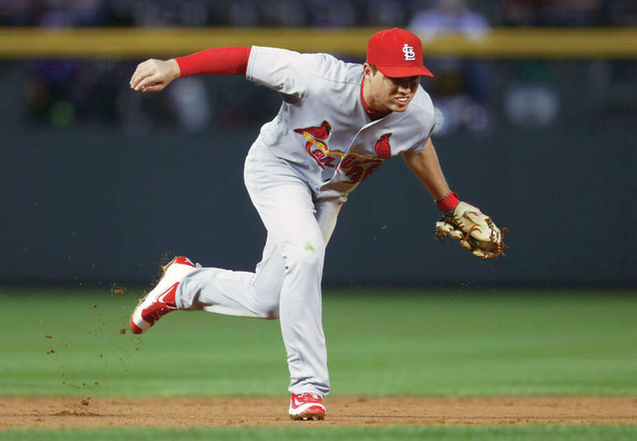 St. Louis Cardinals shortstop Aledmys Diaz fields ground ball off the bat of Colorado Rockies' Nick Hundley. Diaz threw to first base for the out to end the first inning of Monday's game in Denver. Photo: AP
