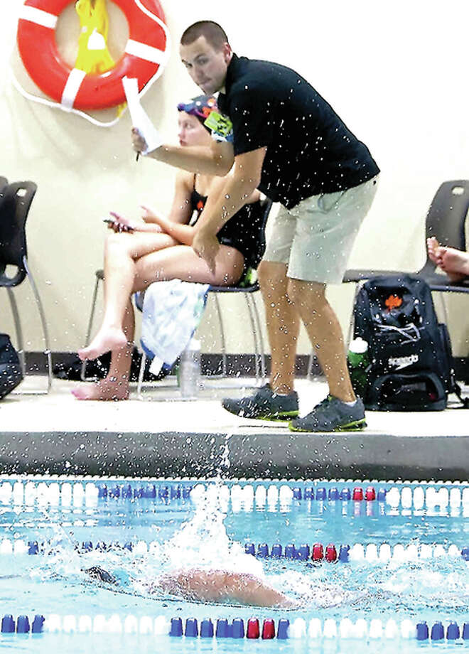 Edwardsville High School swim coach Christian Rhoten urges on one of his swimmers. Rhoten's Tigers will be in action Thursday in Springfield against Sacred Heart-Griffin and host Springfield High School. Photo: Telegraph File Photo