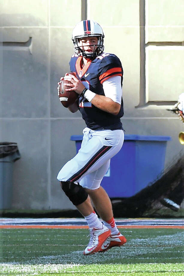 Illinois quarterback Wes Lunt drops back to pass in Saturday's loss to Western Michigan at Memorial Stadium in Champaign. Photo: Cary Frye | For The Telegraph