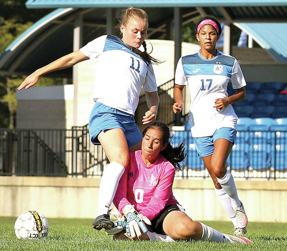 LCCC's Nina Breuer (11) gets tangled with Lincoln goalie Amanda Villa (4) in Wednesday's 10-0 victory at the LCCC Soccer Stadium. Also pictured is LCCC's Adrianna Schindler. Photo: S. Paige Allen | For The Telegraph