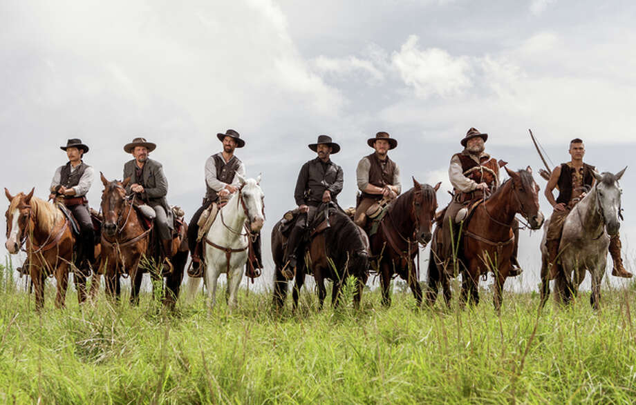 """In this image released by Sony Pictures, Byung-hun Lee, from left, Ethan Hawke, Manuel Garcia-Rulfo, Denzel Washington, Chris Pratt, Vincent D'Onofrio and Martin Sensmeier appear in a scene from """"The Magnificent Seven."""" Photo: (Sam Emerson/Sony Pictures Via AP)"""