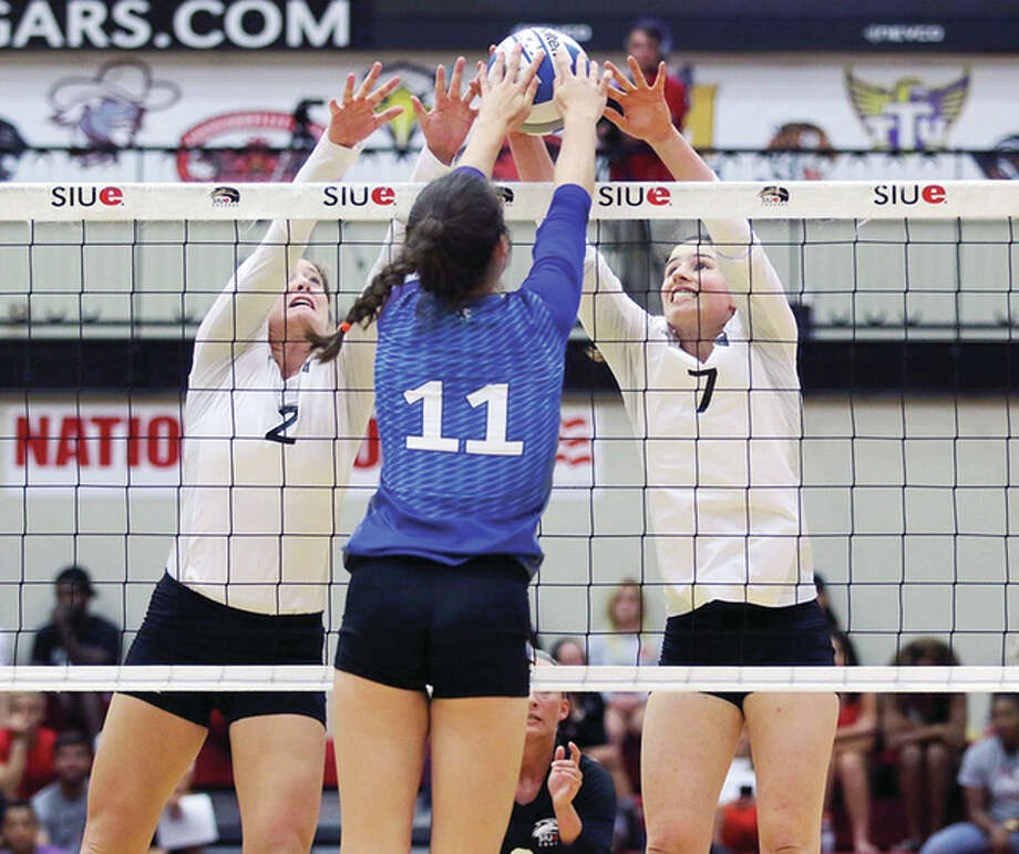 SIUE's Taylor Joens, left, and Jackie Scott go for a block Wednesday against Eastern Illinois University's Abby Knight. Photo: SIUE Athletics