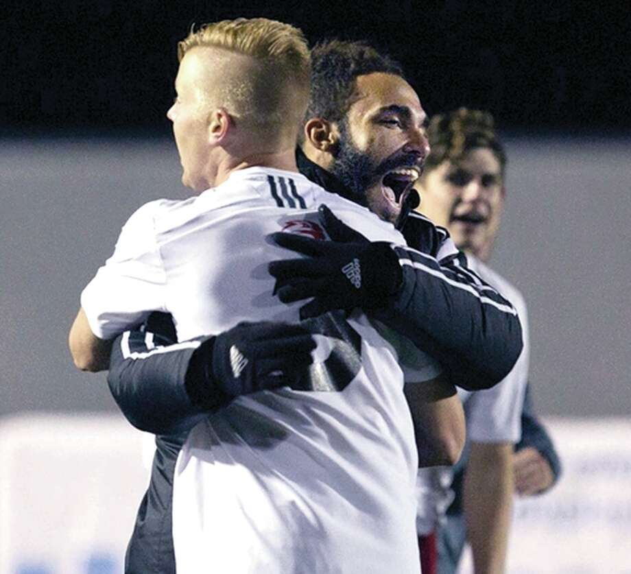 SIUE's Justin Bilyeu, left, and Andrew Kendall-Moullin celebrate the Cougars' 1-0 overtime win Saturday night over Loyola Photo: SIUE Photos