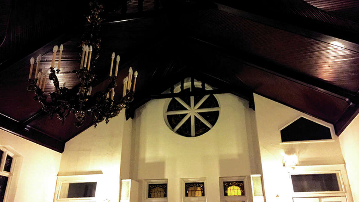 Rev. Phillip Mercer was reportedly found hanging from the right-side transom (rectagular window above the door) on Nov. 20, 1934 in the First Unitarian Church at Third and Alby streets in Alton.