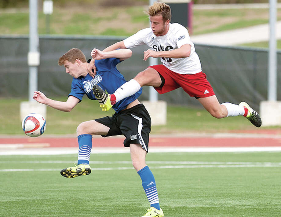 SIUE's Keegan McHugh, right, goes airborne against Drake's Gabe Edel in Sunday's Missouri Valley Conference Tournament championship game at Bob Guelker Field at SIUE. Photo: Howard Ash | For The Telegraph