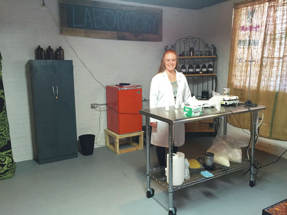 Orb Elements owner Lora Ruppert-Aulabaugh poses in her aromatherapy laboratory in the old Milton Schoolhouse.