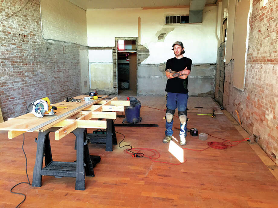 Grand Piasa Body Art owner Chris Hinkle stands inside the new space where his tattoo shop will be located on East Broadway in Alton. Hinkle said he hopes to have the shop ready to open by Jan. 1.