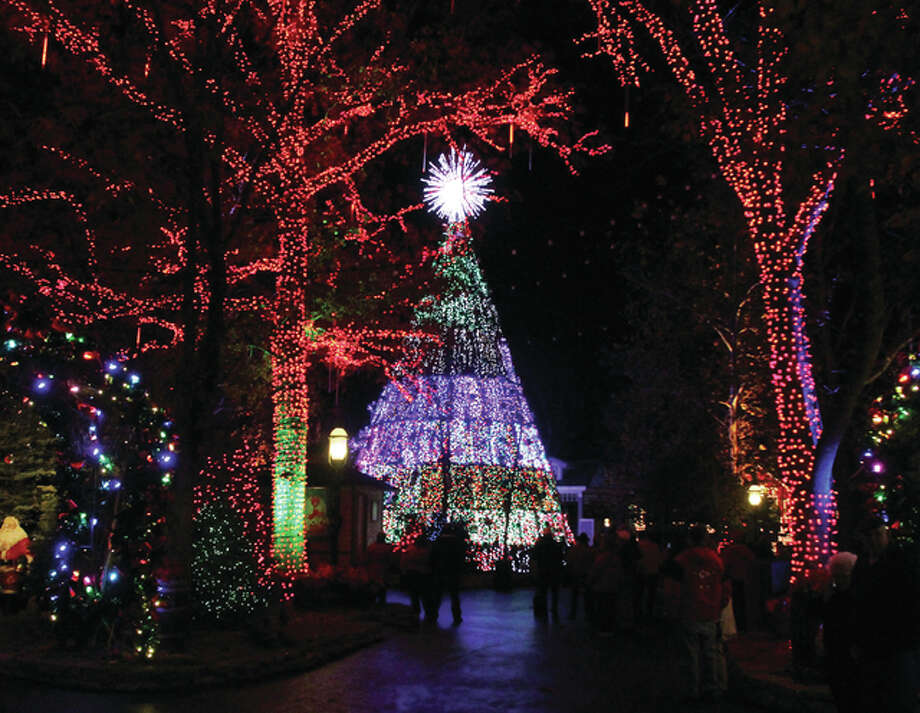 the five story christmas tree at silver dollar city in branson lights up as part