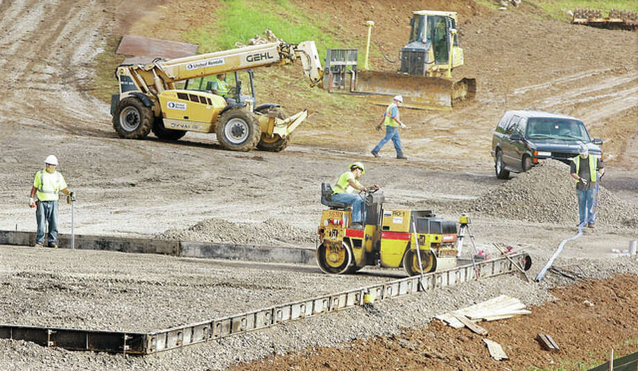 Construction workers are shown laying the groundwork of a $14 million project near the east levee at the mouth of Wood River Creek in East Alton near the power plant on Illinois Route 143 last August. Local officials toured the construction Monday. Photo: John Badman | The Telegraph