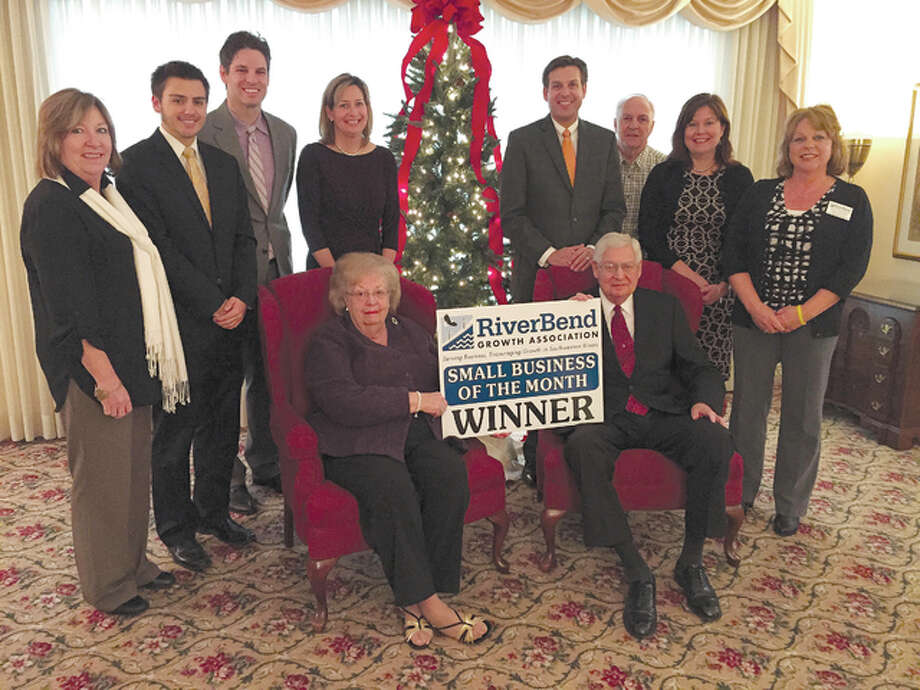 Members of the Gent family, including Les Bowles and Joanne Gent Bowles, seated, were presented with the RiverBend Growth Association's Small Business of the Month award Wednesday. Also pictured are RBGA president Monica Bristow, far left, and Awards Committee chairman Amy Schaake, far right.