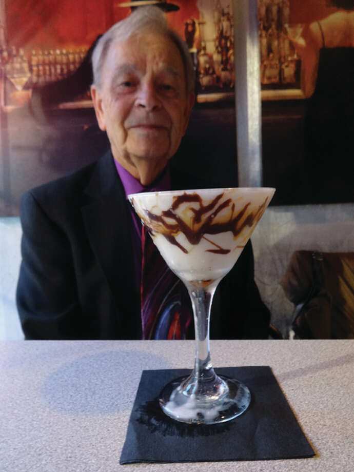 """Bob Hunter, of Bethalto, anticipating drinking his once-a-week martini and No. 22, """"A Streetcar Name Desire,"""" on Chez Marilyn restaurant and cocktail lounge's list of 30 martinis. Photo: Jill Moon 