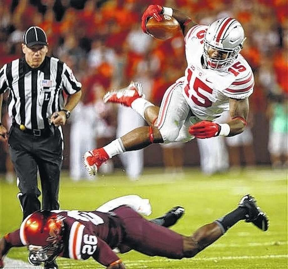 Alton native and Ohio State running back Ezekiel Elliott (15) shown in action earlier this season, will skip his senior season at OSU and declare for ther NFL Draft, it was revealed Thursday by Buckeyes cocch Urban Meyer. Photo: AP File Photo