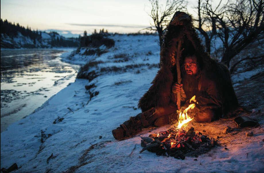 Hugh Glass (Leonardo DiCaprio) struggles to stay warm during a vicious winter. Photo: Twentieth Century Fox Film Corp. | For The Telegraph