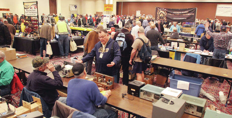 People browse and talk at Winterfest radio swap meet. About 800 ham radio operators and enthusiasts attended the event, held at Gateway Center in Collinsville.