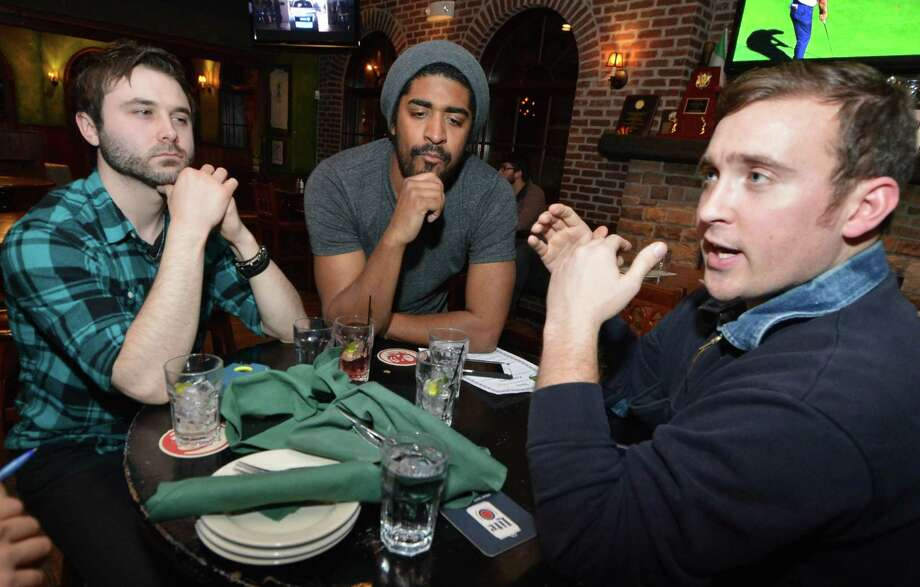 Norman Curry, Luis Piña and Thomas Kochera talk about how dating has changed while having drinks at O'Neill's Pub & Restaurant in South Norwalk on Thursday. Photo: Alex Von Kleydorff / Hearst Connecticut Media / Norwalk Hour
