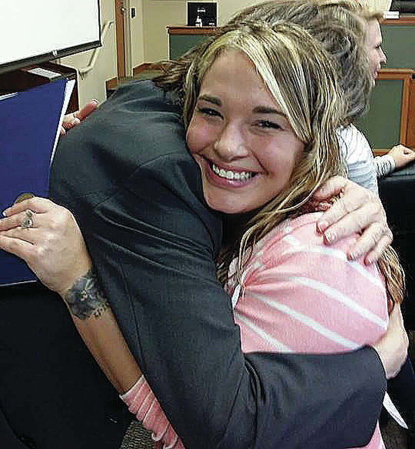 Leanne A. shares an emotional hug with counselor Julie Chastain of Chestnut Health Services after graduating for drug court Tuesday.