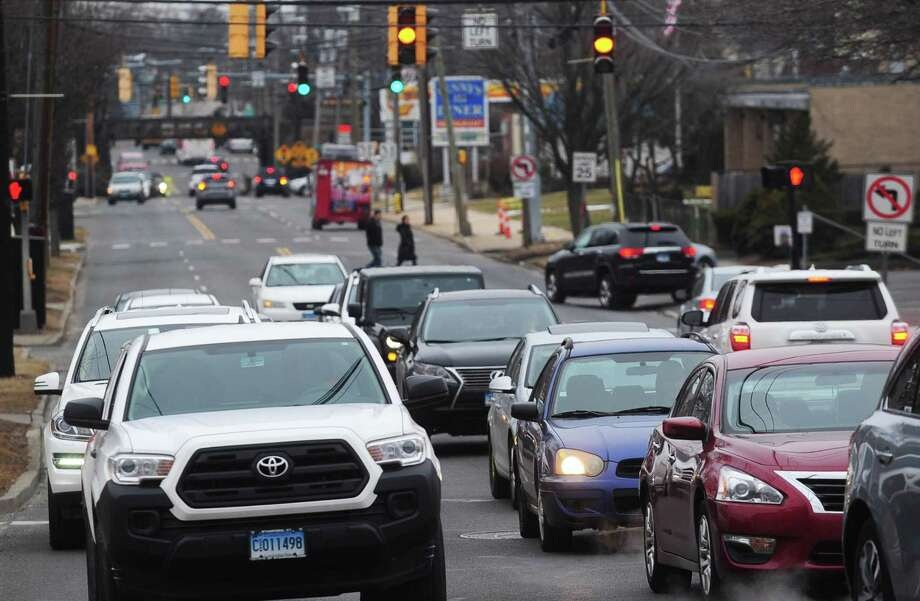 Traffic moves along East Avenue in Norwalk. East Avenue is already a traffic-choked myriad of confusing turn and travel lanes that sparked neighborhood concern several years when the city and Connecticut Department of Transportation paired up several years ago to widen it. With Spinnaker Real Estate Partners plan for a 195-apartment transit-oriented development at the East Norwalk Train Station, the concern over traffic has only grown. Photo: Erik Trautmann / Hearst Connecticut Media / Norwalk Hour