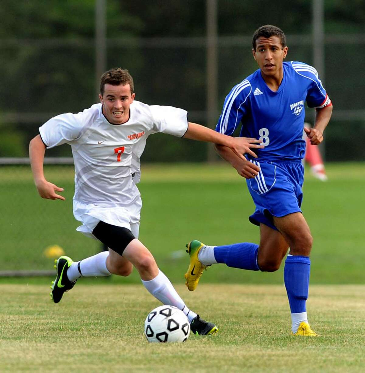 Bethlehem's Mike Mulhass controls the ball as Saratoga Springs' Noah Cadet, right, defends during their soccer game on Thursday, Sept. 17, 2009, at Bethlehem High in Bethlehem, N.Y. High School Sports (Cindy Schultz / Times Union)