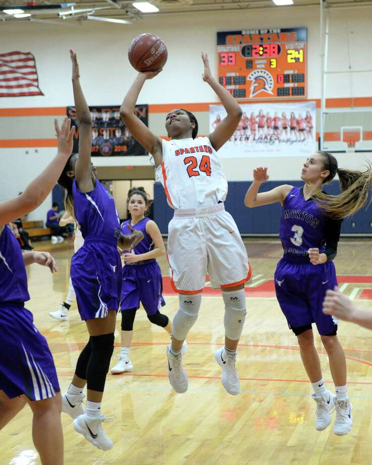 Jada Lake (24) of Seven Lakes attempts a shot during the third quarter of a varsity girls basketball game between the Seven Lakes Spartans and the Morton Ranch Mavericks on Tuesday, February 6, 2018 at Seven Lakes HS, Katy, TX. Photo: Craig Moseley, Staff / ©2018 Houston Chronicle