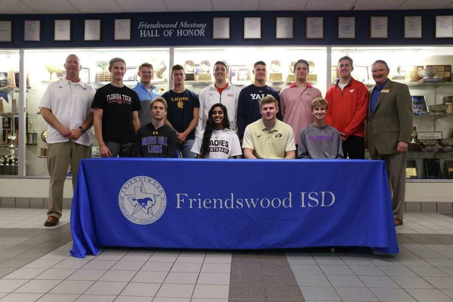 Eleven Friendswood High School athletes signed national letters of intent on Wednesday. Front row, left to right, are Joel Borman (boys lacrosse, Mars Hill University), Priya Ponia (girls' basketball, Centenary College), Jake Yurachek (football, Colorado), Kyle Harner (boys' soccer, Florida Southern) (back row), Friendswood athletic director Robert Koopmann, Thomas McHenry (swimming, Florida Institute of Technology), Luke Adams (boys' lacrosse, Elmhurst), Nick Swaney (football, Texas-A& Commerce), Max Yarbrough (football, Louisiana-Lafayette), Reid Nickerson (football, Yale), Wyatt Hall (football, Davidson College) and Ben Redding (football, SMU), and FHS Principal Mark Griffon. Photo: Submitted Photo