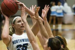 Northwood's Karli Herrington takes a shot during the Timberwolves' game against Michigan Tech on Saturday, Feb. 10, 2018 at Northwood University. (Katy Kildee/kkildee@mdn.net)