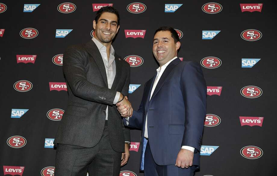 San Francisco 49ers quarterback Jimmy Garoppolo, left, shakes hands with team owner Jed York during an NFL football press conference Friday, Feb. 9, 2018, in Santa Clara, Calif. Garoppolo has signed a five-year contract with the 49ers worth a record-breaking $137.5 million. Click through the gallery to learn more about Garoppolo. Photo: Marcio Jose Sanchez, Associated Press