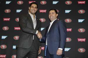 San Francisco 49ers quarterback Jimmy Garoppolo, left, shakes hands with team owner Jed York during an NFL football press conference Friday, Feb. 9, 2018, in Santa Clara, Calif. Garoppolo has signed a five-year contract with the 49ers worth a record-breaking $137.5 million. (AP Photo/Marcio Jose Sanchez)