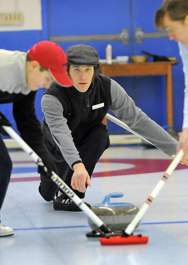 STEVE JACOBS / TIMES UNION , 1/3/09, Albany,NY--  LEARN TO CURL --  Participants practice their  skills in the sport of Curling during an Open House at the Albany Curling Club, Saturday, January 3, 2009. Matt Sundheim,center, delivers the Stone. ( FOR STORY ) 1 of 4 photos Photo: STEVE JACOBS / 00001860A