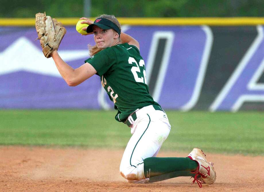The Woodlands second baseman Amanda Curran throws from her knees to throw out Oak Ridge's Kim Manuel in the third inning of a District 16-6A softball game Tuesday. Go to HCNpics.com to purchase this photo, and others like it. Photo: Jason Fochtman / Internal