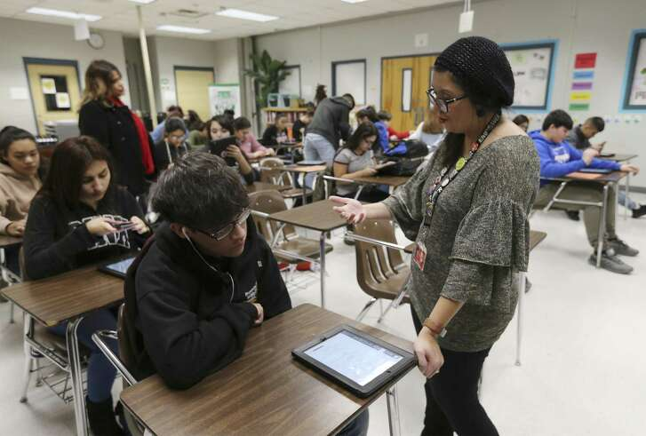 Educator Yvette Maldonado helps Memorial High School students fill out a college course questionnaire on Jan. 18. Dual credit programs offered in local school districts make higher education accessible, reduce financial burdens, and provide a highly skilled workforce and economic growth.